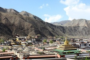 Xiahe's existence is largely dependent on the Labrang  Monastery (with the yellow hat roof). Photo / Jim Eagles