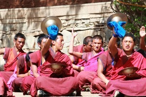 Monks perform a skilful musical performance. Photo / Jim Eagles