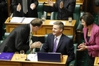 Why is John Key, left, applauding Finance Minister Bill English for his Budget? Photo / Mark Mitchell