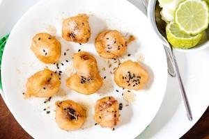 Banana fritters with black sesame, cumin and lime mascarpone. Photo / Babiche Martens