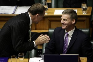 Prime Minister John Key congratulates Finance Minister Bill English after the reading of the budget. Photo / Getty Images