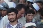 Hundreds of protesters, angered by an overnight NATO raid, that they believed killed four civilians, clashed with security forces on the streets of a northern Afghan city.