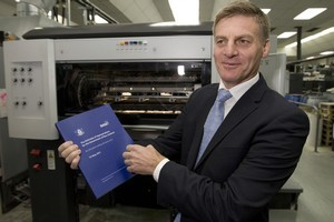 Finance Minister Bill English with a copy of the Budget he will present tomorrow. Photo / Mark Mitchell