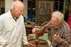 George and Cornelius Geluk fix a table using the workshop's facilities. Photo / Steven McNicholl
