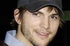 Warner Bros. announced that Ashton Kutcher will replace Charlie Sheen on the hit CBS sitcom 'Two and a Half Men' next fall.
