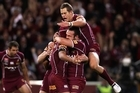 Johnathan Thurston of the Maroons celebrates with team mates after scoring the opening try of the match. Photo / Getty Images