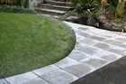 Straight lines are all important when putting in the pavers. Photo / Steven McNicholl