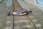 A schoolboy - not Reid Moodie - planking on  railway tracks. Photo / Supplied