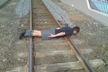 A schoolboy - not Reid Moodie - planking on  railway tracks. Photo / Supplied