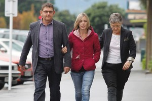 Anna Macdonald, wife of the defendant, arrives at court with her parents, Bryan and Jo Guy. Photo / Mark Mitchell
