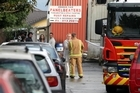 Fire officers talk to eye witnesses after the blaze in Waikaukau Road. Photo / Janna Dixon