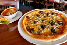 Da Sette Soldi's cannelloni (left) and pizza capricciosa. Photo / Steven McNicholl