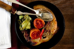 Pork chops, roasted chilli, tamarillos and bok choy. Photo / Babiche Martens