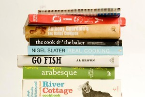 A stack of cookbooks have inspired chef and food critic Nici Wickes throughout the years. Photo / Babiche Martens