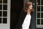 France's first lady Carla Bruni, visibly pregnant, welcomed wives of G8 leaders to a working lunch on the sidelines of the group's summit on Thursday. Bruni's pregnancy had already been made known by her husband's father, but has still not been officially confirmed.