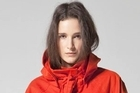 Sherie Muijs' 'Churchward' orange raincoat, $725. Photo / Supplied