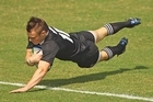 Toby Arnold of New Zealand dives over to score a try. Photo / Getty Images