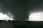 A massive tornado that tore a 6-mile path across southwestern Missouri killed at least 89 people as it slammed into the city of Joplin, ripping into a hospital, crushing cars like soda cans and leaving a forest of splintered tree trunks.