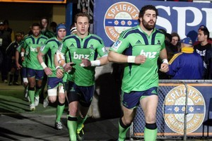 The Highlanders run out on to Carisbrook in their new livery. Photo / NZPA