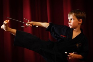 Eight-year-old Matthew O'Connor has achieved his black belt in Shaolin Kempo. Photo / Richard Robinson