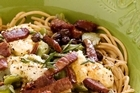 Spelt pasta with broad beans, chorizo and ricotta. (Plates, napkins, cutlery and glasses from French Country Collection.) Photo / Babiche Martens