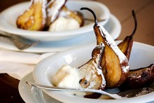 Baked pears with honey and cardamom icecream. Photo / Babiche Martens