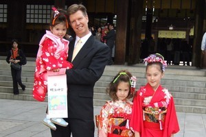 Terrie Lloyd, owner and founder of Tokyo-based LINC Media with his children Monica, Sophie and Eva (left to right) in front of the Meiji Shinto shrine in Tokyo. SUPPLIED