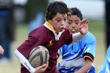Dejae Adlam's Rotorua Maroon team beat Whakatane 48-0 ... but under the Rugby Union's new rules, the score would be officially recorded as 35-0. Photo / APN 