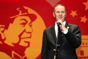 Prime Minister John Key speaking on the stage at the Civic Theatre in Auckland as part of China's 60th anniversary celebrations in September 2009. File photo / Martin Sykes