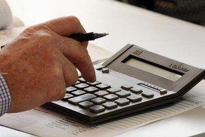 Online calculators are an easy way to check finances. Photo / APN
