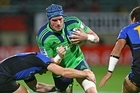 Josh Berkhuis in the new Highlanders jersey is tackled. Photo / Getty Images