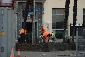 The pictures show six workers tending to a plot outside Alice in Videoland on the corner of High and Tuam Streets. Photo / Newstalk ZB