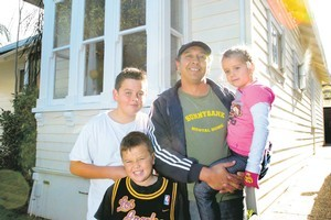 Rob Cobb says the $10,000 he'll get for renting his house out for nine nights will pay for a holiday for his family, including Robert, 12, (left) Charlie, 8, and Lissey, 6. Photo / Brett Phibbs