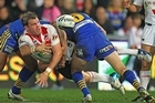 Adam Cuthbertson of the Dragons offloads the ball in a tackle. Photo / Getty Images