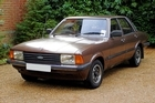 Many great Fords have worn the Ghia badge, including the mighty Cortina, pictured here resplendent in back fence brown. Photo / Wikimedia Commons