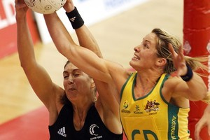 Silver Ferns goal shooter Irene van Dyk and Australia's Julie Corletto contest the ball. Photo / Getty Images