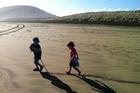 Keeping the kids entertained is easy at Bethells Beach, just allow them to explore the beauty. Photo / Danielle Wright
