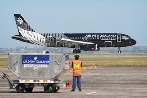 Air New Zealand's new 'All Black' A320 aircraft arrives at the Auckland Domestic Airport. Photo / Natalie Slade