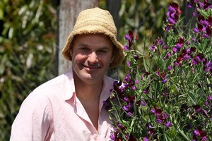 Sweet pea enthusiast Justin shows off his abundant crop. Photo / Natalie Slade