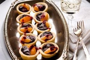 Belgian chocolate tartlets with mandarins and plum powder. Photo / Babiche Martens