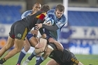 The Blues' Jared Payne is tackled during their match against the Chiefs on Saturday. Photo / Richard Robinson