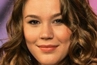 British singer Joss Stone was not at home when two men were arrested outside on the suspicion of committing robbery and murder.