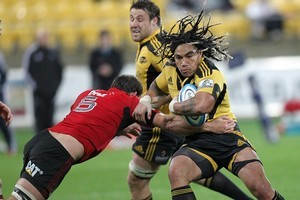 Ma'a Nonu of the Hurricanes is tackled by George Whitelock of the Crusaders. Photo / Getty Images