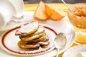 Persimmon jam with lemon pikelets and cream. Photo / Babiche Martens