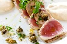 The Vitello Tonnato entrée of seared tuna, roasted veal and crispy capers at Prego. Photo / Babiche Martens