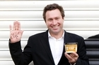 Angus Allan with a yum tub of Russian Fudge yoghurt. Photo / Babiche Martens