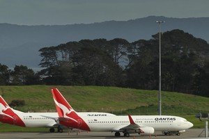 Qantas planes at Auckland International Airport are not going anywhere today as the ash cloud from chile continues to disrupt travel. Photo / Greg Bowker