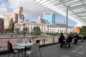 Aotea Square has been spruced up and includes well-landscaped gardens, plus Aotea centre now houses a cafe and bar. Photo / Michael Bradley