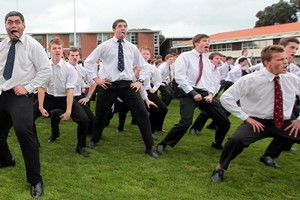 King's College students perform a haka before their victory over rivals Auckland Grammar. Photo / Doug Sherring