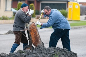 Paul Taylor and Bill Bayfield join the Farmy Army ranks  to help clear liquefaction silt. Photo / David Alexander